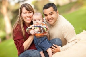 8085214-happy-mixed-race-family-posing-for-a-portrait-in-the-park