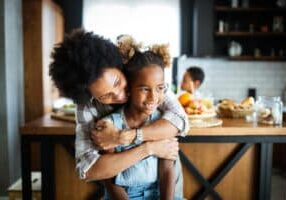 Happy mother and children in the kitchen. Healthy food, family, cooking concept