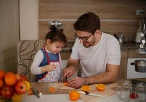 Happy family eating fresh fruits on the kitchen.